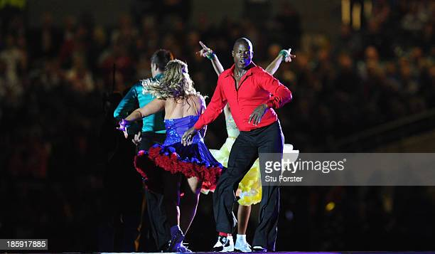 Ex Wigan and England player Martin Offiah struts his stuff during the opening ceremony starts before the Rugby League World Cup Group A match between...