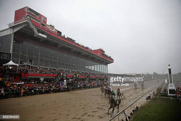 Exaggerator ridden by Kent Desormeaux leads the field to win the 141st running of the Preakness Stakes at Pimlico Race Course on May 21 2016 in...