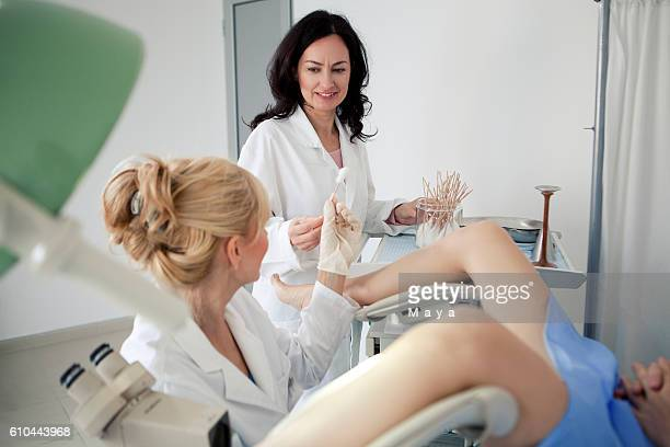 exam at gynaecologist office - pelvic exam stock photos and pictures