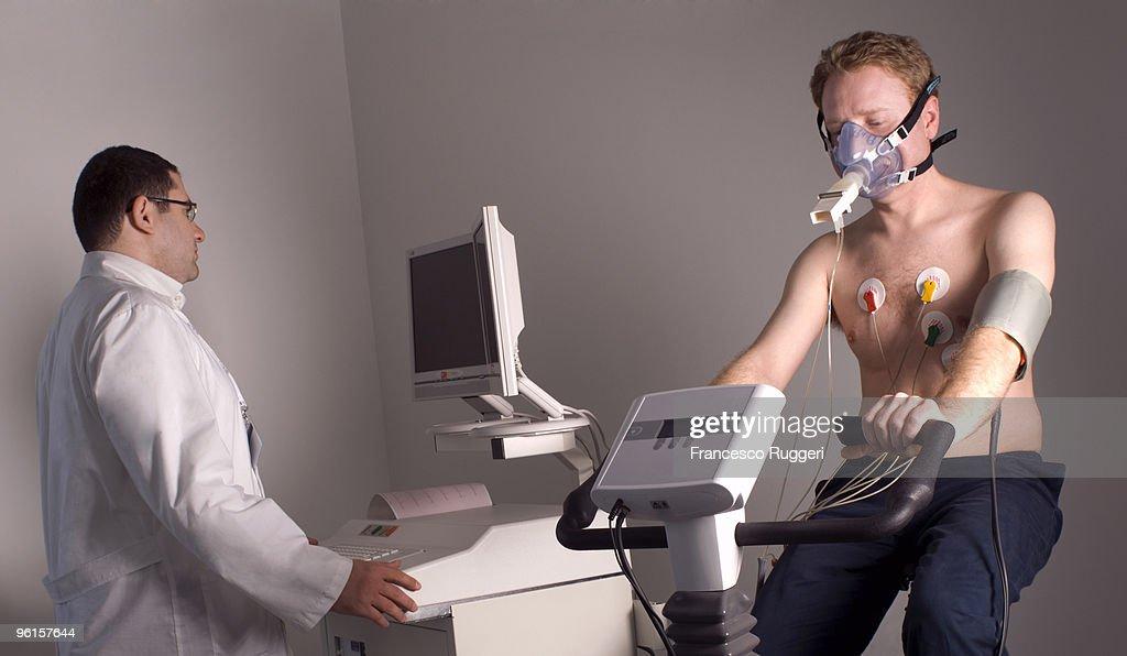 Exam with  ergometer + spirometer by cardiologist : Stock Photo