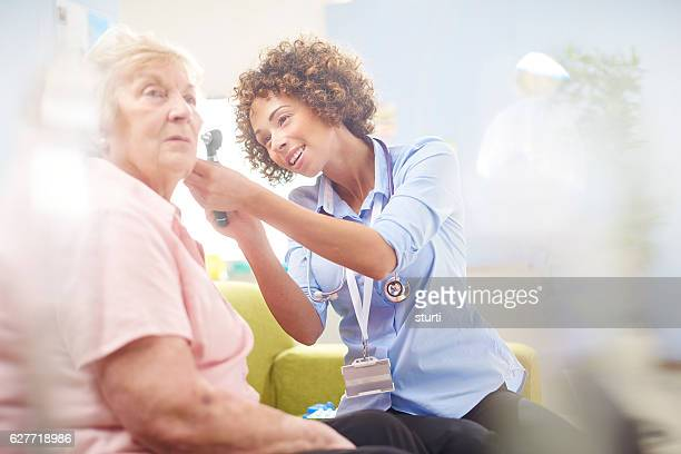 ent examination - ear exam stock photos and pictures