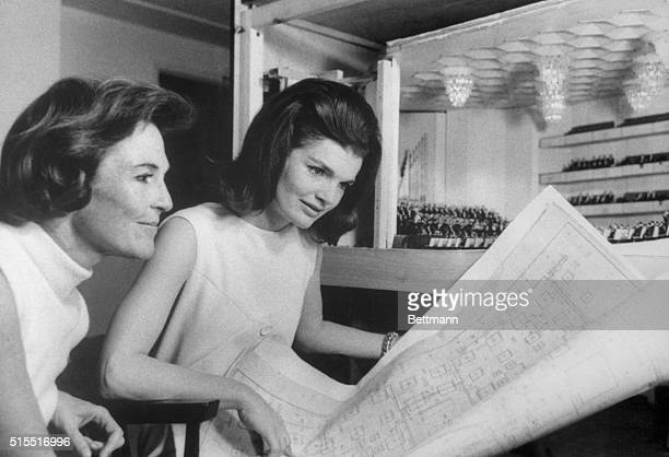 Examine Model of Kennedy Center Mrs Jacqueline Kennedy and Mrs Joan Braden examine a model of the Kennedy Center for the Performing Arts in the...