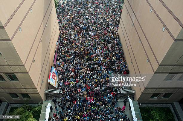 Examinees for the provincial civil services entrance exam wait outside the exam venue at a university campus on April 25 2015 in Wuhan China Feature...