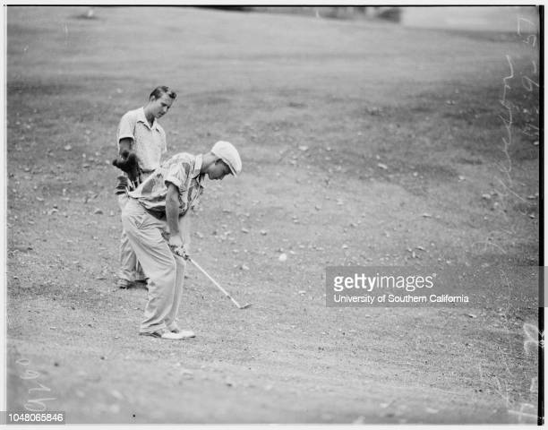 Examiner Junior Golf Tourney at Riviera 10July 1951 Harold Blake putting at eighteenth holeMrs Dorothy Blake mother congratulating sonJohnny...