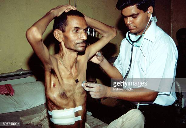 Examining a suspected AIDS and tuberculosis patient Photo by Pallava Bagla/Corbis Sygma