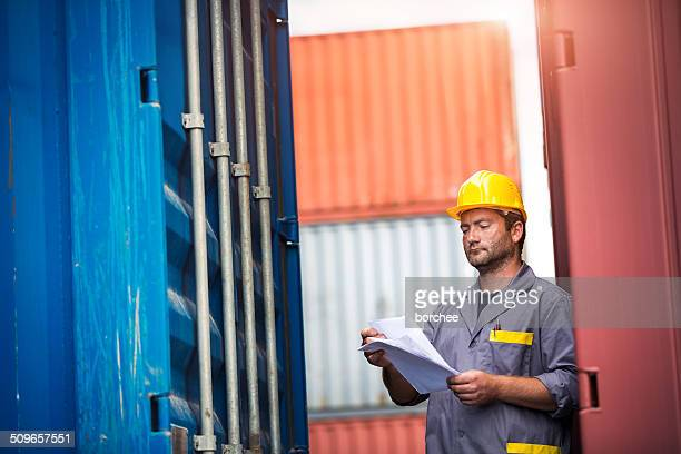 examining containers at commercial dock - koper stock photos and pictures