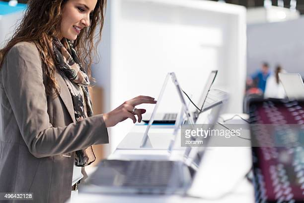 examining laptop - electronics store stock photos and pictures