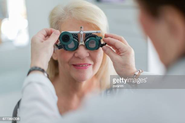 examining patient vision - eye test equipment stock pictures, royalty-free photos & images