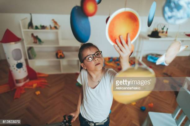 examining solar system model - solar system stock photos and pictures