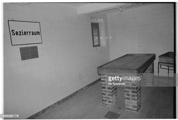 Examining table in camp morgue Examining table in morgue at Mauthausen a Nazi concentration camp in operation during World War II Over 100 000...