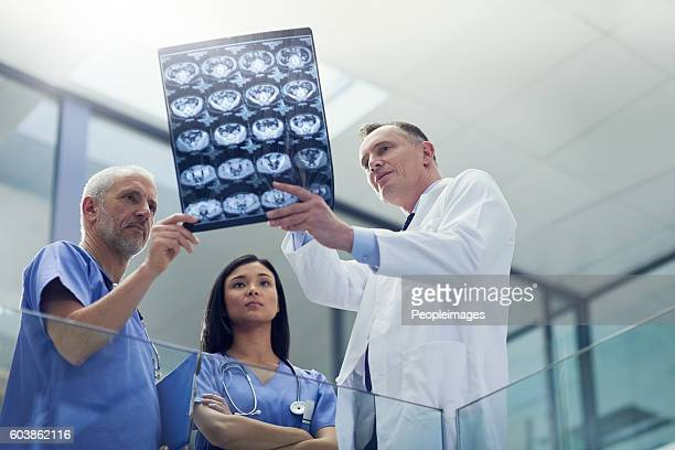Examining the patient's latest scans