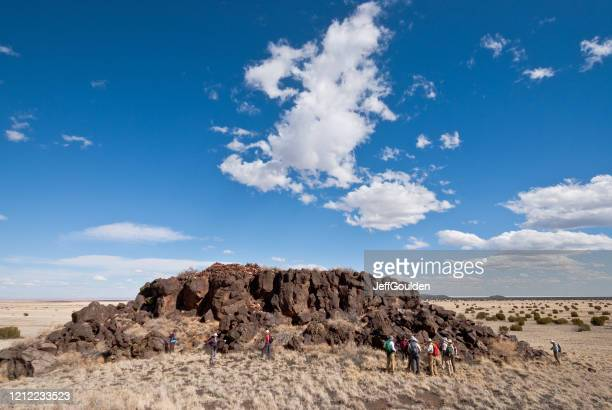 examining the pueblo ruins at east mesa - jeff goulden stock pictures, royalty-free photos & images