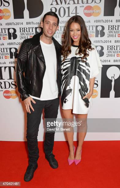 Example and Erin McNaught attend The BRIT Awards 2014 at the 02 Arena on February 19 2014 in London England