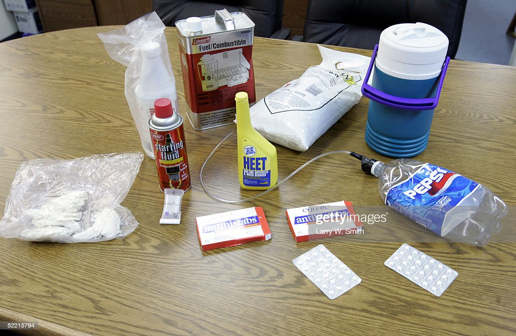 Examples of a items used in the production of methamphetamine, which are used for teaching tools, sit on a table on February 18, 2005 inside the Pratt County Sheriff office in Pratt, Kansas. The Pratt County sheriff office has over 700 square acres of rural land to patrol on a daily basis looking for any kind of methamphetamine substances such as trash or labs.
