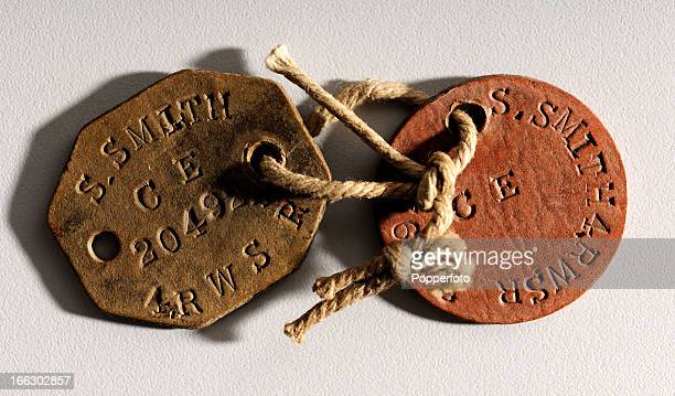 Examples of dog tags or identity tags used by soldiers from the British Army during World War One circa 1917
