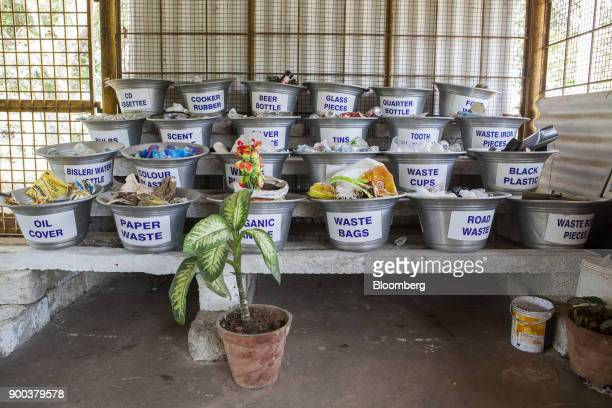Examples of sorted household waste sits in containers at a warehouse in a recycling facility operated by Mysuru City Corp in Mysuru Karnataka India...