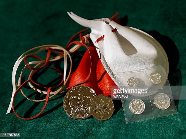 Examples of the two purses on display showing the coins that Britain's Queen Elizabeth II distributed during the Maundy service at Christ Church...