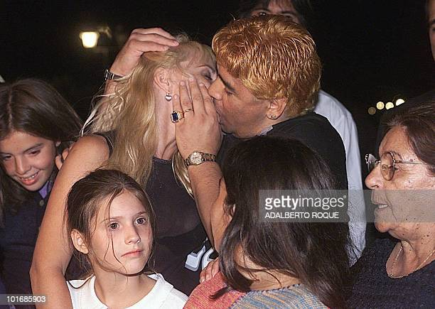 ExArgentine soccer player Diego Armando Maradona kisses his wife Claudia Villafane on the night of 22 January 2000 in the hotel Las Praderas in...