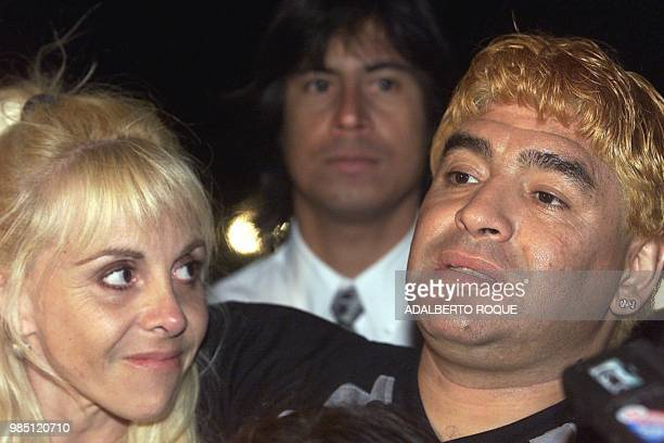 ExArgentine soccer player Diego Armando Maradona next to his wife Claudia Villafane on the night of 22 January 2000 at a hotel in Havana speaks to...
