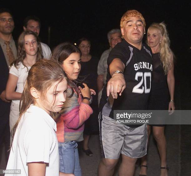 ExArgentine soccer player Diego Armando Maradona poses for a photo with his family on the night of 22 January 2000 at the Hotel Las Praderas in...