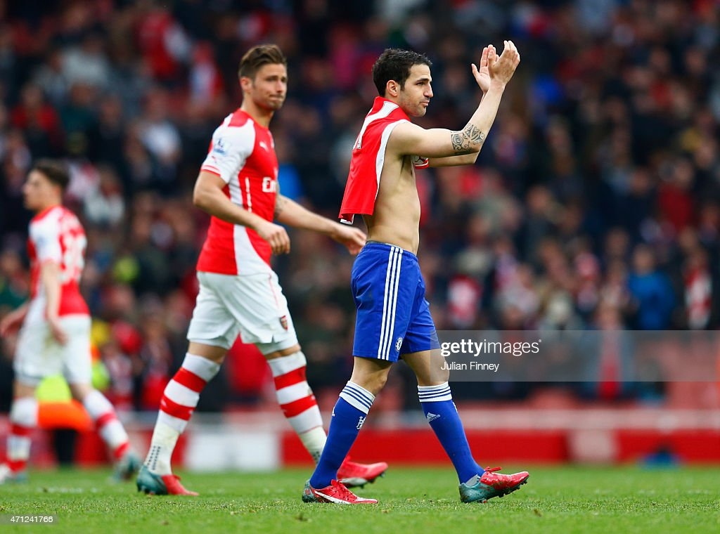 Ex-Arsenal player Cesc Fabregas of Chelsea applauds the crowd after during the Barclays Premier League match between Arsenal and Chelsea at Emirates Stadium on April 26, 2015 in London, England.