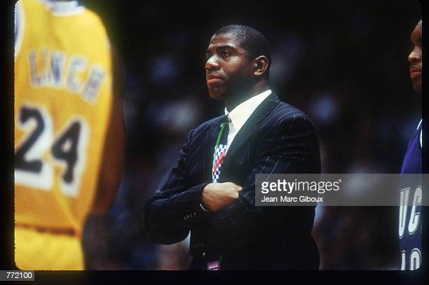ExBasketball star Magic Johnson stands courtside March 27 1994 in Los Angeles CA Before contracting the AIDS virus which eventually led to his early...