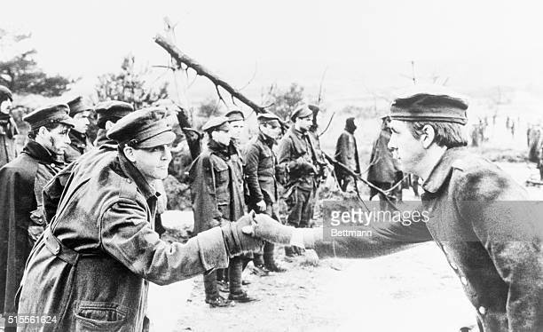 ExBeatle and top recording star Paul McCartney shakes with Paul McCartney in a World War I battlefield scene from a video to promote his title role...