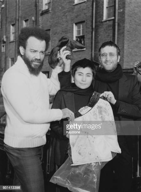 ExBeatle John Lennon and his wife artist Yoko Ono donate their newlycut hair to Black Power leader Michael X in return for a pair of Muhammad Ali's...