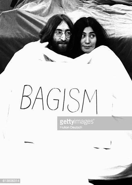 ExBeatle John Lennon and his wife Yoko Ono pop out of a big bag before appearing on the television programme Today