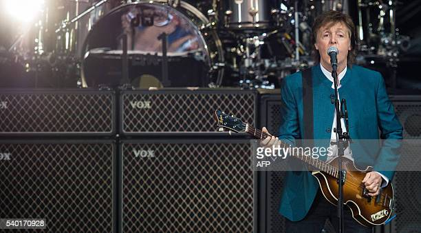ExBeatle Paul McCartney performs on stage during his One on one tour at the Waldbuehne in Berlin on June 14 / AFP / dpa / Sophia Kembowski /...
