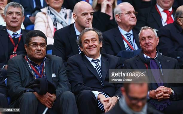 Ex-Benfica footballer Eusebio, UEFA President Michel Platini and Ex-Ajax and Netherlands footballer Johan Cruyff share a joke during the UEFA Europa...