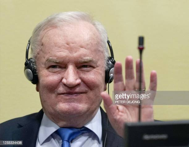 Ex-Bosnian Serb military chief Ratko Mladic gestures from the defendant box during the earing of the final verdict on appeal against his genocide...