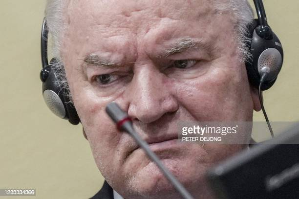 Ex-Bosnian Serb military chief Ratko Mladic looks on from the defendant box during the earing of the final verdict on appeal against his genocide...