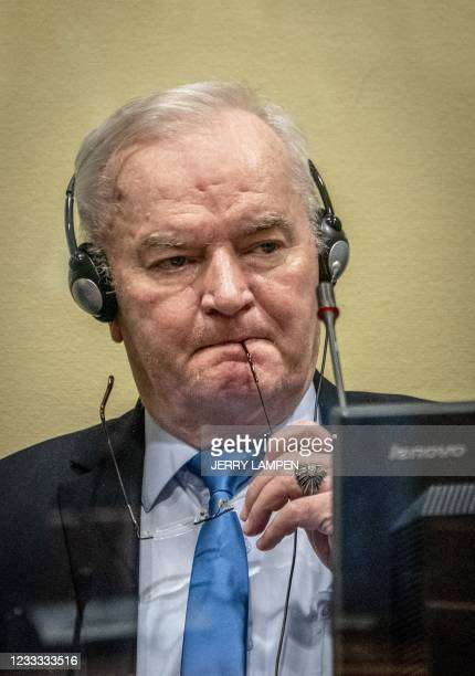 Ex-Bosnian Serb military chief Ratko Mladic looks on from the defendant box prior to the hearing of the final verdict on appeal against his genocide...