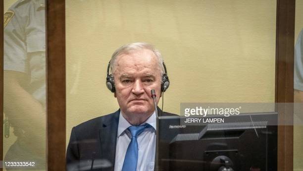 Ex-Bosnian Serb military chief Ratko Mladic sits in the defendant box prior to the hearing of the final verdict on appeal against his genocide...