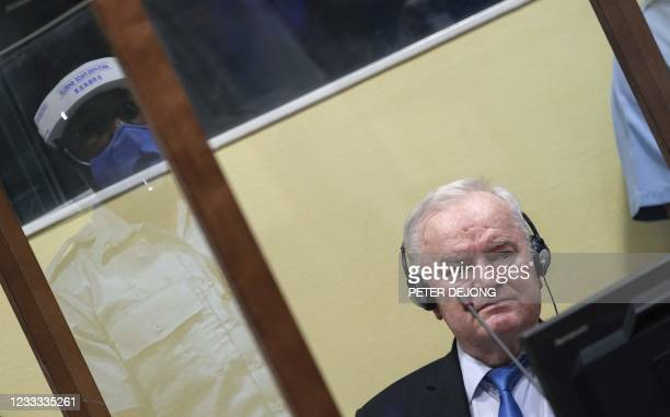 Ex-Bosnian Serb military chief Ratko Mladic sits in the defendant box during the earing of the final verdict on appeal against his genocide...