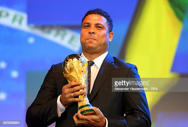 Ex-Brazil international footballer Ronaldo holds the FIFA World Cup Trophy during the Opening Ceremony of the 64th FIFA Congress at the Transamerica...