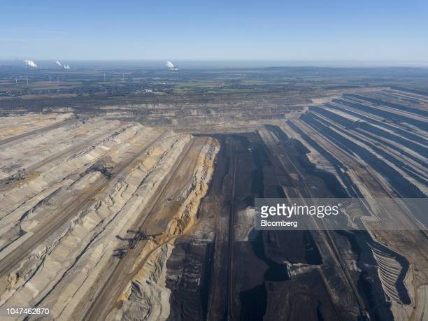 Excavated terrain rests at the open pit lignite mine operated by RWE AG in Hambach Germany on Friday Oct 5 2018 The world must invest $24 trillion in...