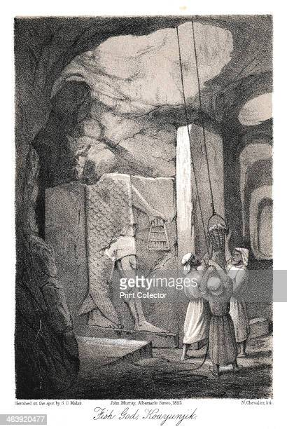 Excavating a low-relief carving of the Fish god Dagon, Nineveh, 1853. Between 1845 and 1851 British archaeologist Austen Henry Layard excavated the...
