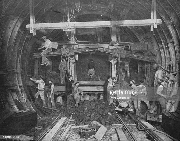 at work in the 'shield' Great Northern and City Railway London circa 1903 The Great Northern City Railway constructed underground tunnels to allow...