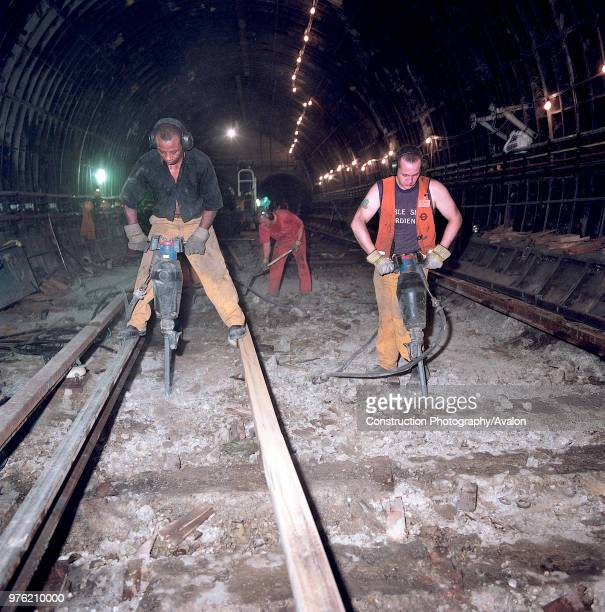 Excavating track bed during refurbishment of Angel Underground station London United Kingdom 27th November 2002