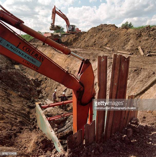 Excavating trench on the Essex marshes to install gas supply pipework for the Barking Reach power station Largest of the Dash for Gas gas fired power...