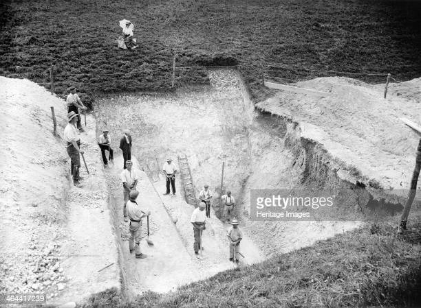 Excavation at Avebury Wiltshire 1909 An excavated section through the Neolithic ditch of the henge monument at Avebury The excavation was undertaken...