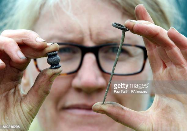 Excavation director Dr Nora Bermingham with a bead and a clothes pin just two of the thousand of artifacts discovered at the crannog site in...