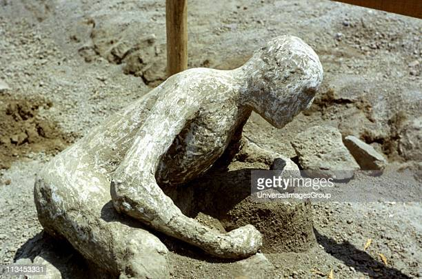 Excavations at Pompei Petrified form of a man in Pompei overcome during the eruption of Vesuvius in 79 AD