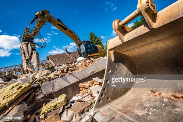 Excavator and bulldozer at a demolition site