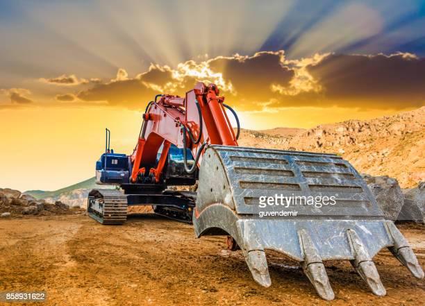 Excavator en solar de construcción
