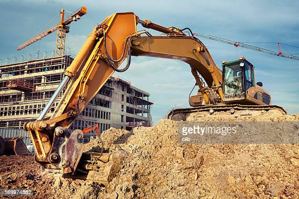 excavator at construction site - excavator stock photos and pictures