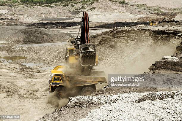 excavator at work in an open-pit mine