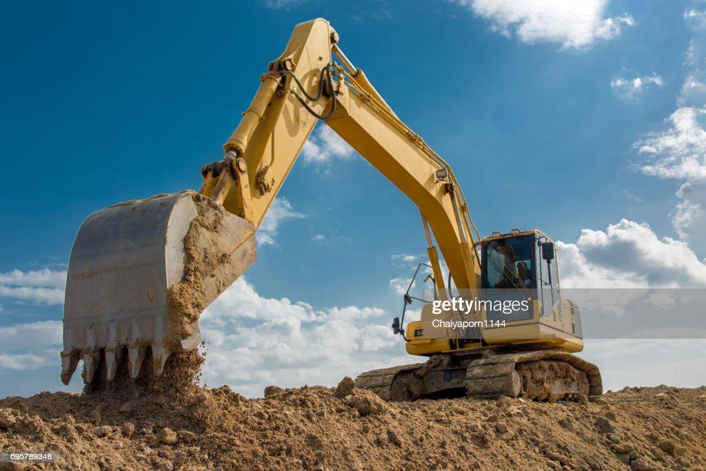 excavator blue sky heavy machine construction site : Stock Photo